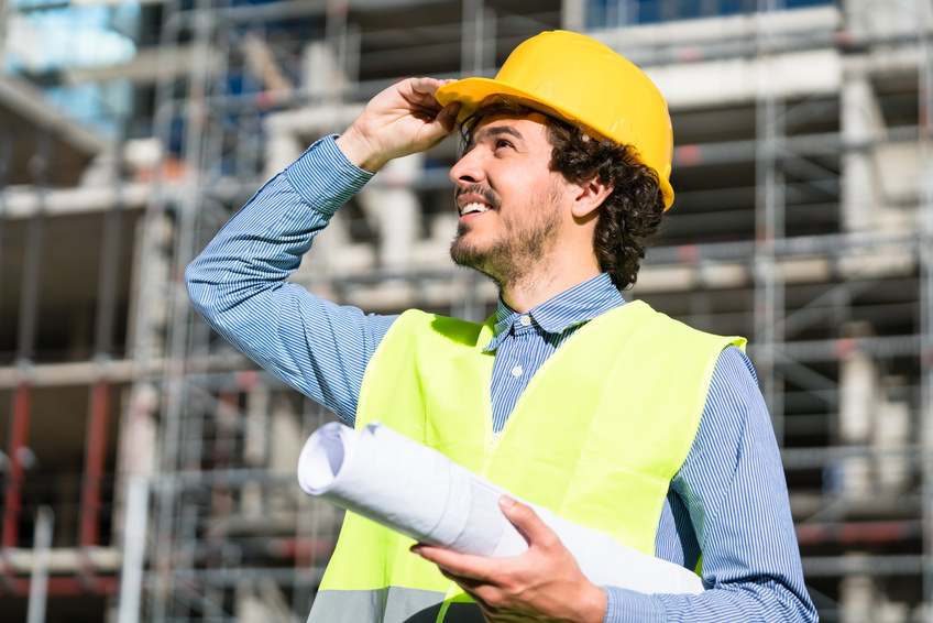 Architect studying floor plan at construction site