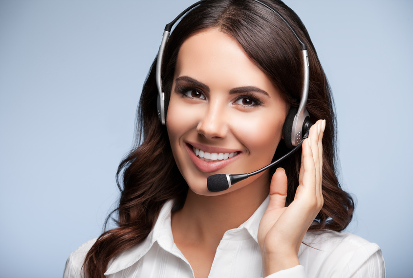 Portrait of happy smiling customer support female phone operator